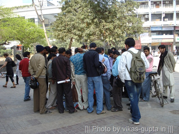 people gathered on street in Delhi, India